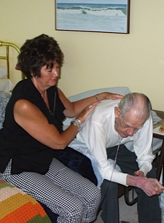 Sandra giving her father reiki